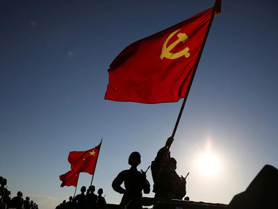 Soldiers carry a PLA flag and Chinese national flags before the